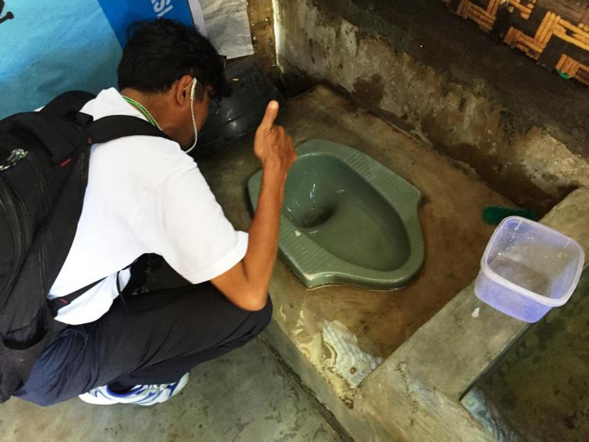 Taking a picture of a toilet in the SEHATI project