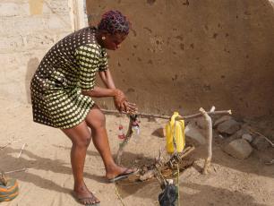 Using a simple handwashing device in Bongo, Ghana