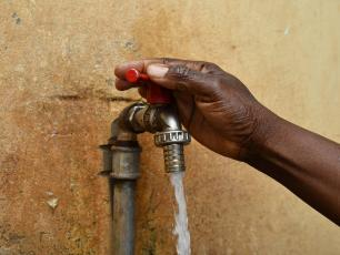 Water tap in Burkina Faso (photo by Anne Mimault)