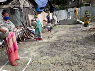 COVID-19 - Social distancing at a handpump in Bangladesh.