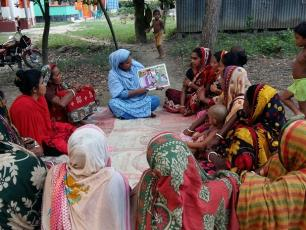 Ms. Naima Akter is facilitating an awareness session on WASH. Photo by: A. Mannan