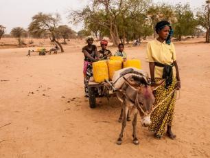 Woman fetching water in northern Burkina Faso
