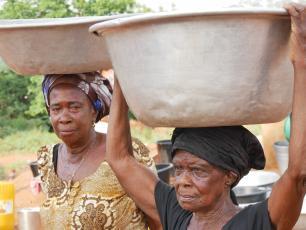 Women carrying water in Wamahinso, Asutifi North District, Ghana