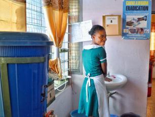 Girl washing hands in Ghana