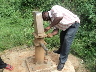 A hand pump mechanic at work in Kabarole District, Uganda