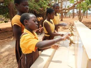 Schoolchildren practising handwashing in Ghana