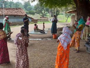 Women and girls receiving handwashing instructions in Jharkhand, India