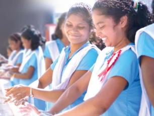 Schoolgirls washing hands