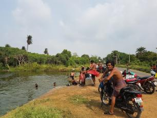 India - fetching water from river in Chatrapur block, Ganjam District, Odisha state