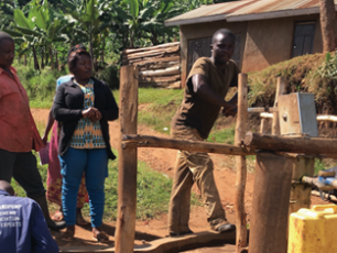 At the water pump in Kabarole District