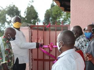 Kabarole chairman R. Rwabuhinga cuts ribbon to open sanitation facility at Bwanika Health Centre II