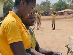 Girls from Kenyasi No2 Model Basic School washing hands