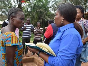 Madam Gloria (Chair WATSAN committee Dominase) in discussion with Rhoda Gyampoh (Community Development Officer - Tarkwa-Nsuaem