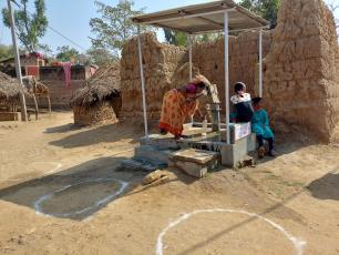 Physical distancing circles at the water point