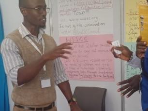 Daniel Karanja at the WSSCC booth during the Sanitation Conference in Kenya