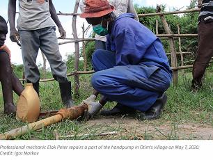Professional mechanic repairs village handpump in Uganda