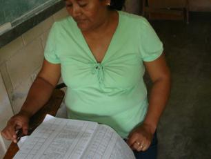 woman checking the financial records of the water committee