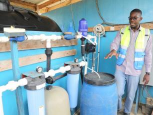 Sylvester Adjapong director of impact and quality for Access Development explains the Nexus purification system at Sekyere Aboab